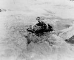 Harry Houdini (1874-1926) swims river in scene from The Man from Beyond, released in 1922. The movie included Houdini swimming the Niagara falls, but it is not confirmed if the image shown here is indeed at the Niagara falls.