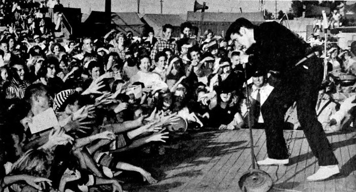 Elvis performing live at the Mississippi-Alabama Fairgrounds in Tupelo, Mississippi, September 26, 1956