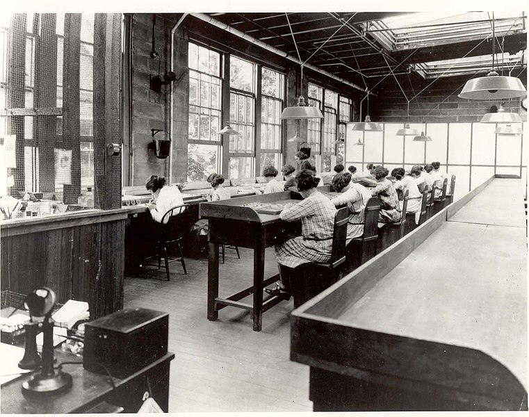 Radium Girls work in a factory of the United States Radium Corporation. Date circa 1922